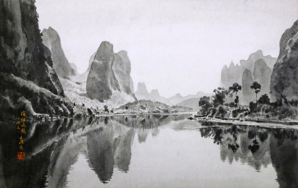 The Li River reflection in the still water.
